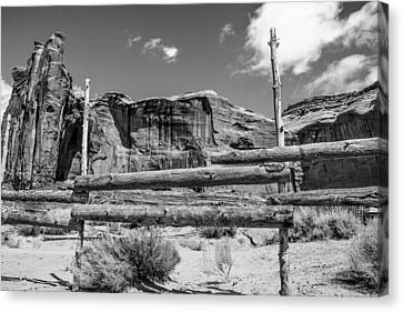 Fence In Monument Valley - Bw Canvas Print by Dany Lison