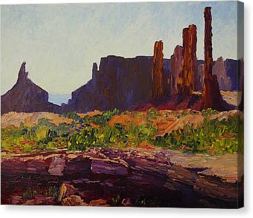 Monument Valley Totem Poles Canvas Print by Terry  Chacon