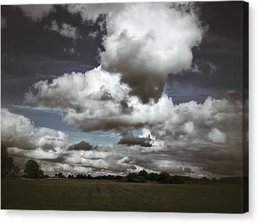 Moodiness In The Clouds Canvas Print by Karen Stahlros