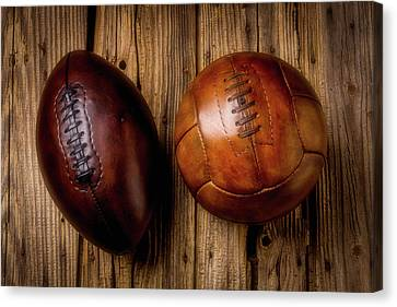 Moody Football And Soccer Ball Canvas Print by Garry Gay