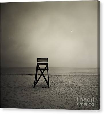 Moody Lifeguard Stand On Beach. Canvas Print by John Greim