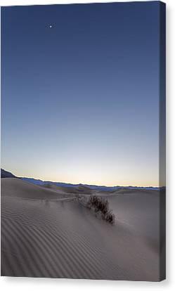 Moon In The Desert Canvas Print by Jon Glaser
