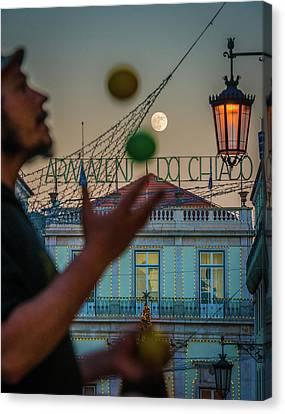 Moon Juggler Canvas Print by Cory Dewald
