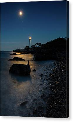 Canvas Print featuring the photograph Moon Light Over The Lighthouse  by Emmanuel Panagiotakis