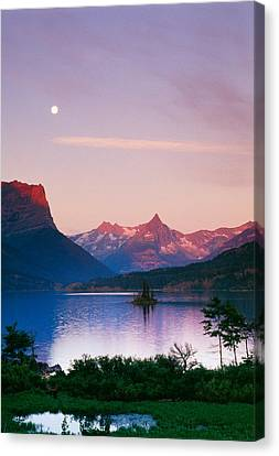 Moon Over Mountains And Saint Marys Lake Canvas Print by Panoramic Images