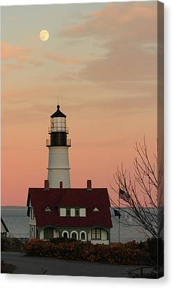 Moon Over Portland Head Lighthouse Canvas Print by Lou Ford