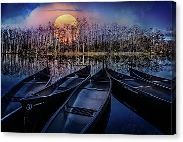 Canvas Print featuring the photograph Moon Rise On The River by Debra and Dave Vanderlaan