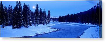 Thaw Canvas Print - Moon Rising Above The Forest, Banff by Panoramic Images