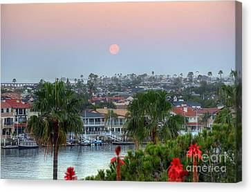 Canvas Print featuring the photograph Full Moon Setting In Corona Del Mar by Eddie Yerkish