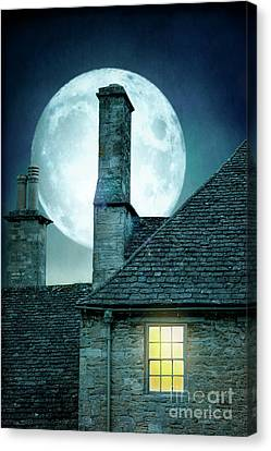 Canvas Print featuring the photograph Moonlit Rooftops And Window Light  by Lee Avison