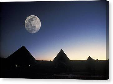 Moonrise Above Giza Pyramids In Egypt Canvas Print by Richard Nowitz
