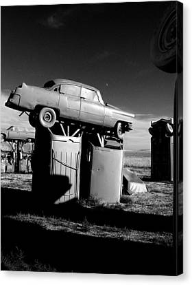 Moonrise Over Carhenge Canvas Print by Todd Fox