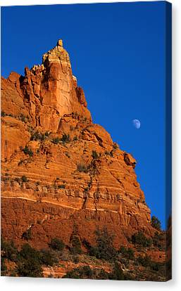 Moonrise Over Red Rock Canvas Print by Mike  Dawson