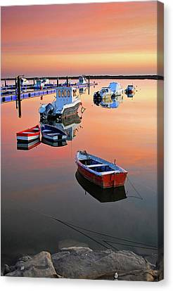 Moored Boats On Sea At Sunset Canvas Print by Juampiter