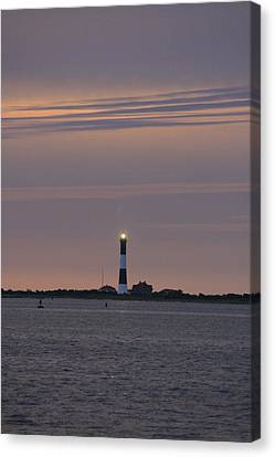 Morning Flash Of Fire Island Light Canvas Print by Christopher Kirby