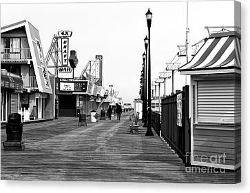 Morning On The Boardwalk Canvas Print by John Rizzuto