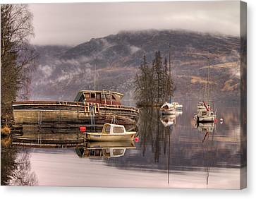 Morning Reflections Of Loch Ness Canvas Print by Ian Middleton