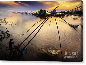 Morning With Fishermen Canvas Print by Buchachon Petthanya