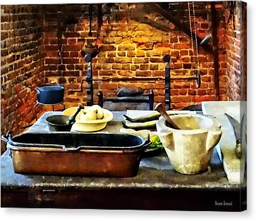 Mortar And Pestles In Colonial Kitchen Canvas Print by Susan Savad