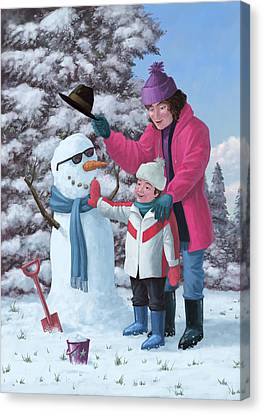 Mother And Child Building Snowman Canvas Print by Martin Davey