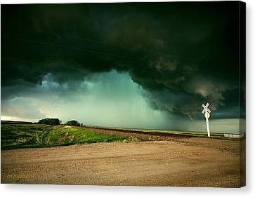 Mother Nature Arrives By Rail Canvas Print by Brian Gustafson