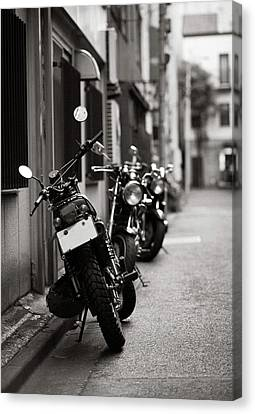 Motorbikes Parked On Street In Tokyo, Japan Canvas Print by photo by Jason Weddington