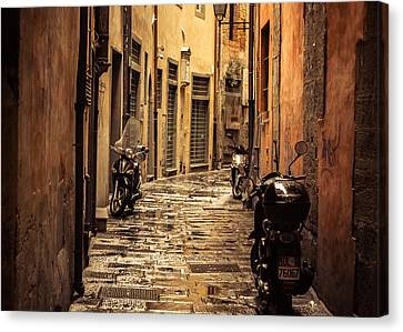 Motorcycle Alley Canvas Print by Chris Fletcher