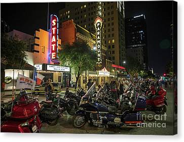 Motorcycle Enthusiasts Take Pictures While Checking Out The Hund Canvas Print