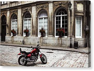 Motorcycle In Old Montreal Canvas Print by John Rizzuto