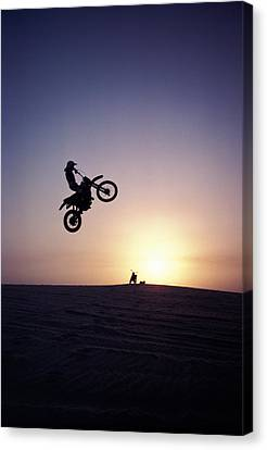 Motorcyclist In Mid-air Jump Canvas Print by James Porto
