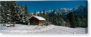 Mountain Cabin And Snow Covered Forest Canvas Print