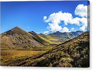 Canvas Print featuring the photograph Mountain Range And Valleys In Kerry In Ireland On A Sunny Day Wi by Semmick Photo