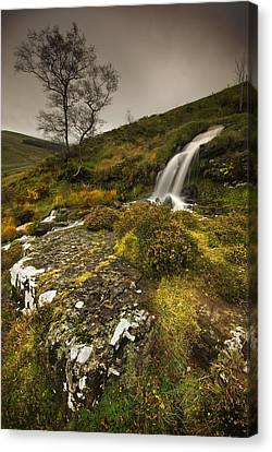 Mountain Tears Canvas Print by John Chivers
