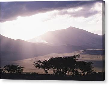 Cosmic And Atmospheric Phenomena Canvas Print - Mountains And Smoke, Ngorongoro Crater by Skip Brown