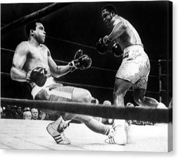 Muhammad Ali Knocked Down By Joe Canvas Print by Everett