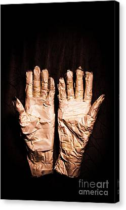 Mummy's Hands Over Dark Background Canvas Print
