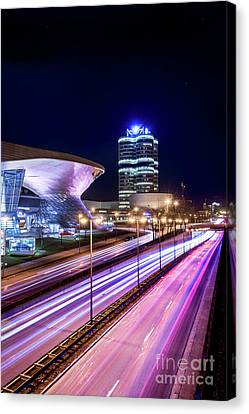 Canvas Print featuring the pyrography Munich - Bmw City At Night by Hannes Cmarits