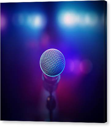 Musical Microphone On Stage Canvas Print by Johan Swanepoel