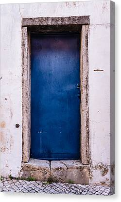Mysterious Blue Door Canvas Print by Marco Oliveira