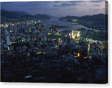Nagasaki Overlooking Its Harbor At Dusk Canvas Print by James L. Stanfield