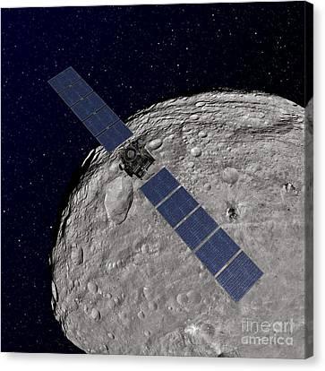 Nasas Dawn Spacecraft Orbiting Canvas Print by Stocktrek Images