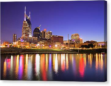 Downtown Nashville Canvas Print - Nashville Skyline At Night On The Cumberland River by Gregory Ballos