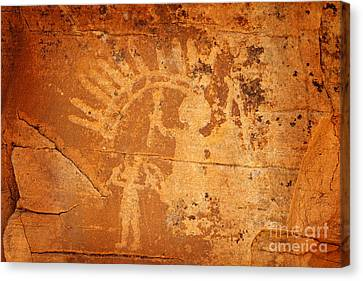 Native American Father And Son Warriors Petroglyph On Orange Sandstone Canvas Print by John Stephens