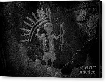 Native American Warrior Petroglyph On Sandstone Canvas Print by John Stephens