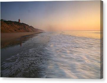 Nauset Light On The Shoreline Of Nauset Canvas Print by Michael Melford