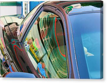 Canvas Print featuring the photograph Neon Reflections On A Black Car by Polly Castor
