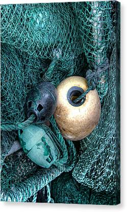 Nets And Buoys Canvas Print by Lynn Jordan