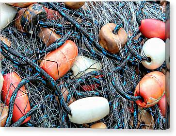Nets With Orange And White Buoys Canvas Print by Lynn Jordan
