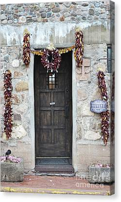 Canvas Print featuring the photograph New Mexico Red Chili Ristras Door by Andrea Hazel Ihlefeld