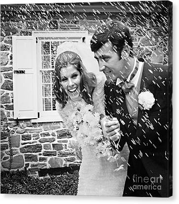 Wedding Bouquet Canvas Print - Newlyweds Showered With Rice, C.1960-70s by H. Armstrong Roberts/ClassicStock